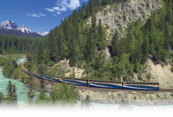 The train passing throughthe Canadian Rockies